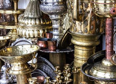 Metal utensil stamping on Moroccan market